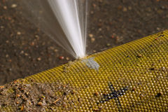 Close-up of a leaking hose. Fire hose with water spurting out through a hole Royalty Free Stock Photo