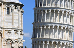 Close-up of leaning tower and cathedral in Pisa. At this picture the restoration of the Leaning Tower of Pisa has just finished. The Torre pendente di Pisa is Royalty Free Stock Images