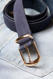 Close up of leather belt on jeans Royalty Free Stock Image