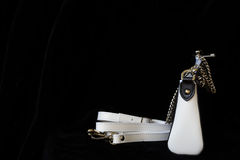 Close-up of leather handbag, always classic combination, black and white color with strap and chain, low key. For modern. Close-up of leather handbag, always royalty free stock photo