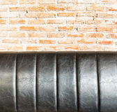Close up Leather sofa at orange brick wall Royalty Free Stock Image