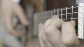Close up of left hand playing guitar stock video