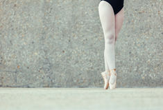 Close up of legs of ballet dancer standing on toes Stock Photos