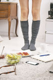 Close up of legs casual asian woman in home. Royalty Free Stock Images