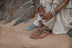Close up of legs with ethnic accessories Stock Photography