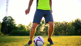 Close up legs and feet of football player in action wearing black shoes running and dribbling with the ball playing on stock footage