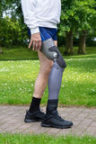 Close up on legs of man walking on path Royalty Free Stock Image
