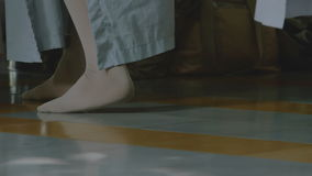 Close-up of legs of monks. Close-up of legs of praying monks stock video footage