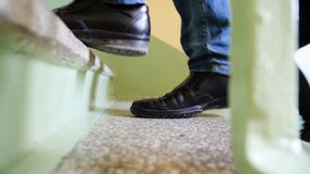 Close up legs of the people walking stepping up stair in the city, go, success, grow up business concept. Legs up the. Stairs closeup Royalty Free Stock Photography