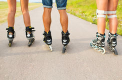 Close up of legs in rollerskates skating on road Royalty Free Stock Photography