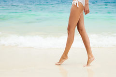 Close up legs walking along the sea sid Stock Images