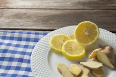 Close up of lemon and ginger slices in plate Royalty Free Stock Photo