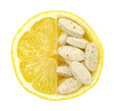 Close up of lemon and pills isolated Stock Photos