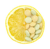 Close up of lemon and pills isolated Stock Images