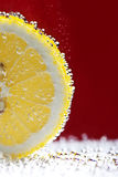 Close-up of lemon slice  with bubbles Stock Image