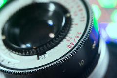 Close-up lens Photo Film camera with multicolored lights in the Royalty Free Stock Photography