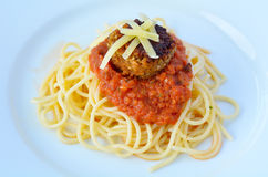 Close up of lentil meatball with burst tomato pasta Royalty Free Stock Image