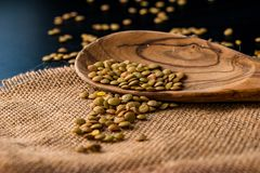 Lentil seeds in a wooden spoon Stock Images