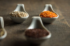 Close up of lentils and quinoa in white spoons on wood Stock Image