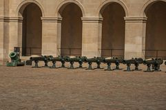 Close-up of the Les Invalides Palace courtyard, with old cannons in a sunny day at Paris. stock images