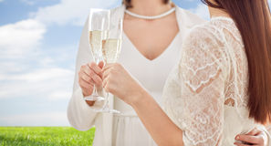 Close up of lesbian couple with champagne glasses Stock Photo