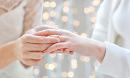 Close up of lesbian couple hands with wedding ring Stock Image