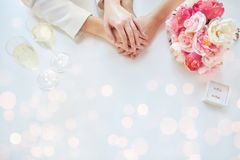 Close up of lesbian couple hands and wedding rings Royalty Free Stock Images