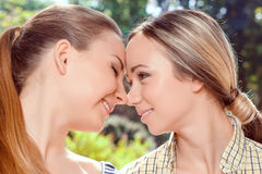 Close up of lesbian couple outdoors Stock Images