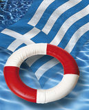 Close up of life belt with greek flag floating on water Royalty Free Stock Images