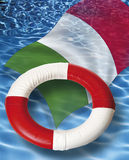 Close up of life belt with italian flag floating on water Royalty Free Stock Photos