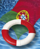 Close up of life belt with portuguese flag floating on water Stock Photos