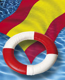 Close up of life belt with spanish flag floating on water Royalty Free Stock Images