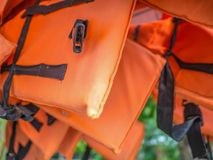 Close up Life jacket. Orange Life jacket in the zoo near the river stock photography