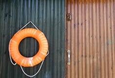 Close-up of a lifebelt on a wooden door. Stock Photos