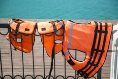 Close-up of Lifejackets on the lake in the background. Close-up of life jackets on the lake stock photography