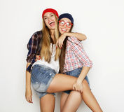 Close up lifestyle portrait of two pretty teen girlfriends smili Stock Photo