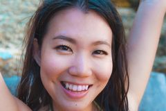 Close up lifestyle portrait of young beautiful and happy Asian K stock photography