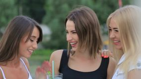 Close-up lifestyle portrait of young best friends girls having fun at cool sunset.Travel concept,happy girls make. Picture together and having fun stock footage