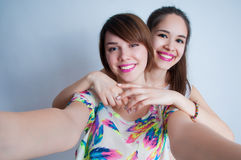 Close up lifestyle selfie portrait of two young positive woman stock photos