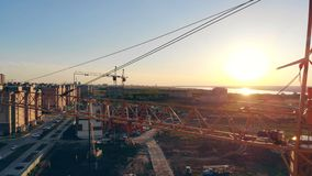 Construction site from above. 4K. Close up of a lifting crane in an unfinished city district. 4K stock video footage