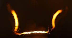 Close up light bulb isolated filament glow slow flashing. Light bulb isolated filament glow slow warm light flashing on black background 4k stock footage