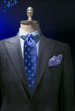 Light Gray Checkered Jacket With Checkered Shirt, Blue Polka Dot. Close-up of a light gray checkered jacket with blue checkered shirt, blue polka dots tie and stock images