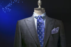 Gray Checkered Jacket With Checkered Shirt, Blue Polka Dots Tie. Close-up of a light gray checkered jacket with blue checkered shirt, blue polka dots tie and Stock Photos