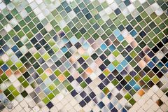 Close up light green mosaic tile . Stairs covered with tiny mosaics. Image for background, wallpaper and copy space royalty free stock photo