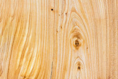 Close-up light natural unpainted knotted wooden pattern of Hardwood texture. Background for design and decoration Royalty Free Stock Photo