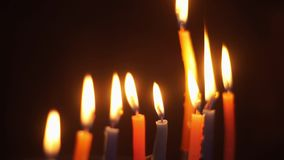 Close-up of the lights candles tremble circling at the corners stock footage