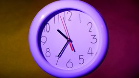 Close up of an lilacclock on colorful background. Close up of an white office clock on colorful background with clipping path. At 10:35 times stock video
