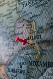 Close up of Lilongwe pin pointed on the world map with a pink pushpin royalty free stock photography