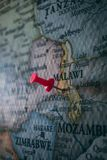 Close up of Lilongwe pin pointed on the world map with a pink pushpin royalty free stock image