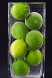 Close up of limes in vase with water Royalty Free Stock Image